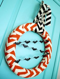 """I want to make this wreath. Two kinds of chevron fabric (orange 3"""" thick, black 2"""" thick, baker's twine for attaching bats, cut out and glitter bats)."""