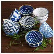 assortment of patterned blue and white bowls
