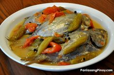 Pinangat na Isda is a Filipino Fish dish. There are two popular versions of Pinangat: the sour version using bilimbi (kamias); and the Bicol version with gata. This recipe is the sour version.  Pinangat na Isda is one of the simple Filipino Food that I like eating. There is nothing fancy about this dish, yet I enjoy having it. Maybe it is because