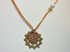 simple gear and pearl necklace. $8.00, via Etsy.