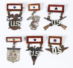 Lot 836: World War II US Sterling Silver and Enamel Sweetheart Pins; Six items with blue stars on a rectangular bar pin; two are marked sterling; together with a cardboard and glass display case