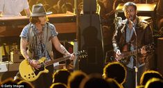johnny depp wows at the mtv movie awards as he shows off his guitar skills alongside the black keys