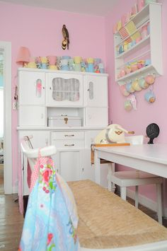 t's a lot of pastel for a kitchen, but very cheerful.  LOVE the white hutch.