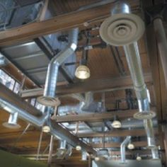 Exposed duct work in the ceiling can give a contemporary look.