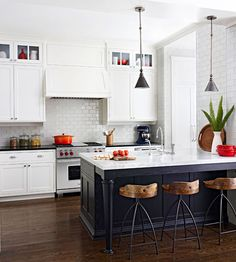 Dark floors & island, double uppers, subway tile