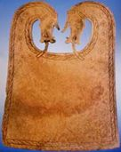 Photo of a whalebone plaque from the Scar burial site