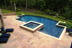 Curved infinity-edge pool and spa. #swimmingpools