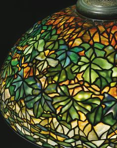 "Tiffany Studios A RARE ""MAPLE LEAF"" TABLE LAMP. (Detail)"