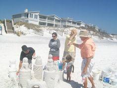 building family sandcastles