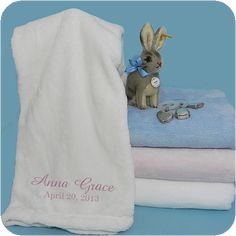 "Fleece Blanket   Buy a few and keep them on hand for last minute baby gifts. Did we mention how ultra soft they were?!  Easy to embroider.   100% Micro Fiber Polyester 29"" x 43""   Choose from: Baby Blue, Pink, or White"