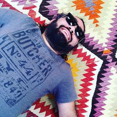 @mehmetic claims he's doing an impression of #thedude but I think it's just an excuse to sleep on the job! These #kilims aren't going to unpack themselves! #labordaysale #turkishrugs #textiles #longbeach #dspatterns @urbanamericana #taoofthedude #jeffbridges #biglebowski
