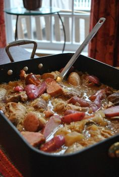 Shortcut Choucroute with bratwurt, pork chops, kielbasa, potatoes and apples  - Three Many Cooks
