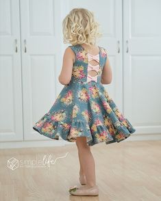 Aria's Bow back top and dress by Simple Life Pattern Company. loaded with options, Aria features a simple back or an adorable bow back. You can do the open bow back or a covered modest bow back. Many sleeves, circle skirt or gathered with ruffle hem. Fast easy beginner friendly modern sewing pattern.