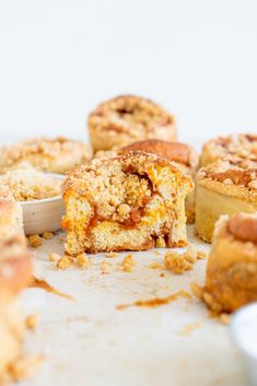Fluffy brioche cinnamon buns are topped with an apricot compote and a brown sugar streusel, and baked into perfect round crumb buns.