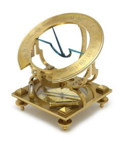 A large gilt brass A. Moretti Inclining dial, signed A. Moretti Roma INSTRUMENTS DES SCIENCES, with blued metal gnomon, hour ring engraved with Roman numerals moving over a 180 degree arc, supported by a bracket above inset brass compass rose with blued steel needle under glass cover, raised on four levelling screws, the base 7 1/2in (19cm) square