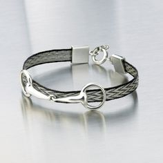Nannasalmi makes the most beautiful jewelry from woven horse hair and precious metals.. I adore it.