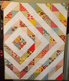 Moda charm pack quilt: this might be useful for an upcoming charm swap with my modern quilt guild