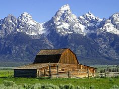 Wyoming barn with Grand Tetons in the background, northwestern Wyoming,