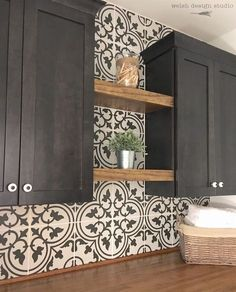 Tile on the wall and shelves between cabinets