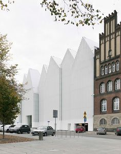 Barcelona-based Barozzi Veiga won a competition to design the Szczecin Philharmonic Hall for the coastal city of Szczecin, in north-west Poland//