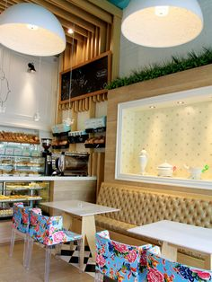 Valentina Bakery: Colombia mademoiselle chairs help create a playful but luxurious interior. Recessed wall detail.