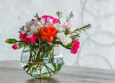 Keep cut flowers looking fresher for longer by placing a few drops of bleach to the water in the vas... - fotosearch.com