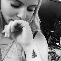 Wrist tattoo of a pine tree. Tattoo artist: Jon Boy