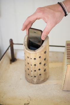 "Made in Haiti from natural bamboo, this clever little smartphone speaker uses no batteries or electricity. Simply drop your phone in and enjoy! Splits and cracks in bamboo will sometimes occur. 4"" x 8""t"