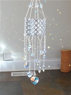 moroccan swarovski crystal heart mobile by Susanelizabethjewels Crystal Wind Chimes, Diy Wind Chimes, Glass Wind Chimes, Bead Crafts, Diy And Crafts, Perfumes Vintage, Diy Accessoires, Mobiles, Suncatchers