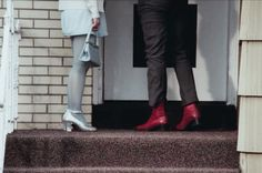 "His-and-hers cool footwear in ""Buffalo '66"" (1998). Bonus points for the handbag."
