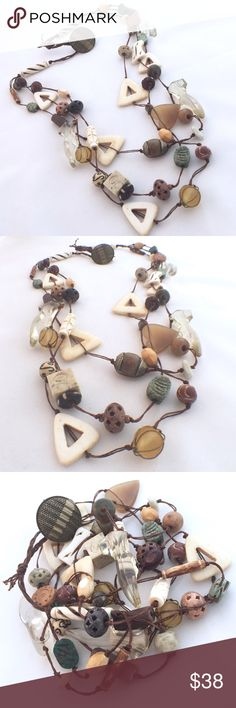 "Ethic Necklace This Ethnic necklace has many unusual beads on it - check out the vintage shoes. Everything has been knotted on waxed linen. The length  of necklace runs around 32"" long. Rare Earth Jewelry Necklaces"