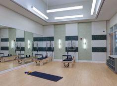 Private yoga/pilates studio with pilates reformers at AMLI Evanston, a luxury apartment community near Chicago.