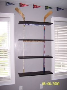 This works for the trophies. But what about all the medallions?!?! Hockey stick for curtain rod and voila! He's going to love how his room looks since being away most of the summer at nanny and papas.
