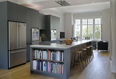20 Beautiful Kitchens Moms Would Love! Roundhouse Urbo matt lacquer bespoke kitchen with built-in book storage Home Decor Kitchen, Kitchen Living, Kitchen Interior, New Kitchen, Kitchen Furniture, Space Kitchen, Kitchen Themes, Kitchen Chairs, Kitchen Ideas