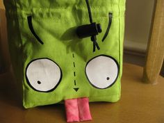 robot alien dog double sided dice bag. $30.00, via Etsy.