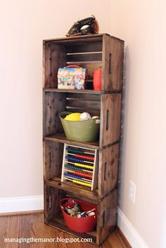 Easy to make corner storage...crates from Home Depot + blow torch + stain=brillant.