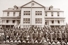 Children pose in front of the girls dormitory building at the Tulalip Indian School in 1912.