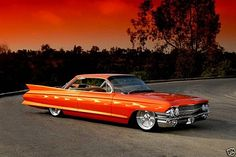 Orange 1961 Cadillac Deville