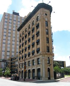 The Flatiron Building; Houston Street at West 9th, Fort Worth, Texas.  At the time it was built, it was considered to be a very tall building at 7 stories and merchants were complaining about the shadow that it would cast.