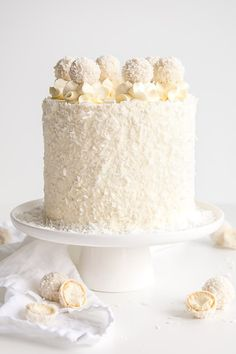This Raffaello Cake is a coconut lover's dream! Layers of moist and tender almond cake, coconut custard, and coconut Swiss meringue buttercream! Food Cakes, Gourmet Cakes, Cupcake Cakes, Raffaello Cake, Amaretto Cake, Cake Recipes, Dessert Recipes, Flour Recipes, Coconut Custard