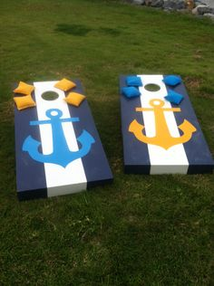 These corn hole  boards were purchased unfinished, hand painted and then coated with polyurethane. Anchors Aweigh! Perfect for my Naval Academy son and Delta Gamma daughters.