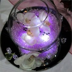 Easy DIY fish bowl centerpiece idea for a purple wedding.