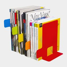 These powder-coated steel bookends by Hiroaki Watanabe ($25) will not only add bright pops of color, but allow you to easily organize and sort all kinds of reads such as magazines, books, and journals, by type. (Dwell)
