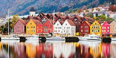 """It was the place that inspired """"Frozen"""" after all.If you need a break from all the gray you see outside, then you need to take a trip to Bergen, Norway.In particular, the historic district of Bryggen is one of the most beautiful places we've ever seen. The tall and slim wooden townhouses are painted"""