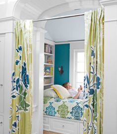 """This California home's shiplike guest bed is enclosed by Anthropologie curtains. The teal walls are painted """"English River"""" by Dunn-Edwards."""