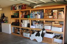 Garage Shelves to Keep Your Small Appliances: Dog Shape Trimmings White Boxes Cement Floor Garage Shelves ~ dickoatts.com Garage Inspiration
