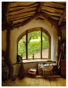 cob home - these are hand formed from mud/straw/sand.  Last centuries, hold their heat in winter and stay cool in summer, no putting off chemicals and best of all, make you feel like you're in hobbit land!
