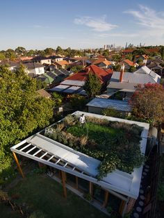"""Emilio Fuscaldo house. Coburg, Australia.  """"At over 500 square feet, the house's green roof may be its most powerful—and most expensive—environmental statement. It cost $8,000 to waterproof, and $7,000 to landscape. Water from the roof feeds the toilet and the garden's watering system, and the garden itself insulates the house and keeps gas bills low in winter."""" Photo by Nic Granleese."""