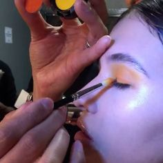 More details on the makeup backstage #highlights with #extradimension  #skinfinish #FeelTheHeat 🔥🔥🔥 #WinterSunset 🌅@carmenmarcvalvo #NYFW  #AW17  #ColorWashing MAC Director of Makeup Artistry @romerojennings  Eye Shadow in Chrome Yellow, Red Brick added later and Passionate, Technakohl Liner in Risqué, and Dazzleshadow in Last Dance.  #MACShop #NYFW #FW17 #romerojennings  #romerojenningsbeauty  @nyfw Gloss was added in lineup!