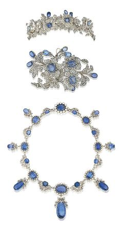 AN IMPORTANT 19TH CENTURY SAPPHIRE AND DIAMOND NECKLACE, TIARA AND CORSAGE ORNAMENT. Comprising a fringe necklace of graduated sapphire and old-cut diamond clusters joined by diamond floral and foliate connections, suspending a series of sapphire and old-cut diamond drops, mounted in silver and gold, circa 1830; a tiara designed as a spray of old-cut diamond dog roses, with cushion shaped sapphire centres and buds, among diamond-set foliage; a corsage ornament of similar design, circa 1860